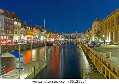 Nyhavn district colorful buildings at Copenhagen, Denmark - stock photo