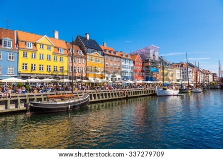 Nyhavn district is one of the most famous landmark in Copenhagen in a summer day - stock photo