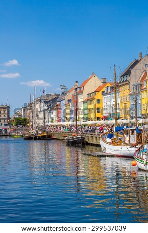 Nyhavn district is one of the most famous place in Copenhagen, Denmark in a summer day - stock photo