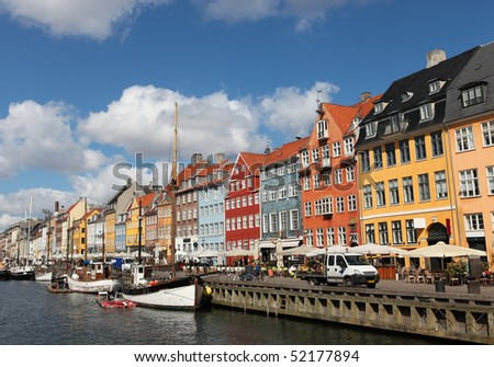 Nyhavn in Copenhagen, Denmark - one of the most popular tourist places of the Danish capital - stock photo