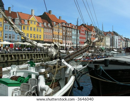 Nyhavn in the old part of Copenhagen with cafes and restaurants - stock photo