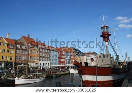 Nyhavn or New Harbor in the center of Copenhagen - stock photo