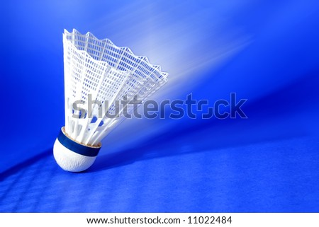 nylon badminton shuttlecock with blue background