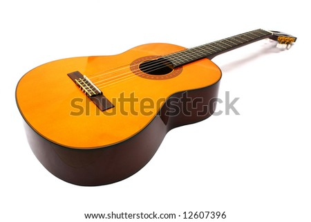 Nylon guitar laid down and view from it's body. - stock photo