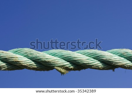 nylon rope against blue sky - stock photo