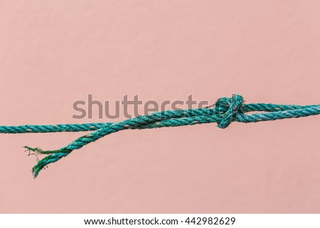 Nylon rope is about to break - stock photo