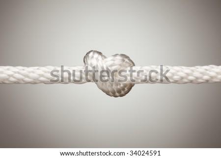 Nylon Rope Knot on a Spot Lit Background. - stock photo