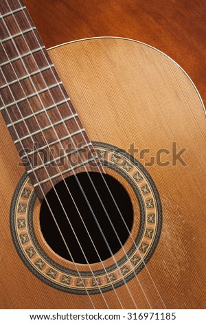 Nylon string acoustic guitar detail. - stock photo