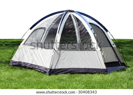 Nylon tent sitting on the green grass - stock photo