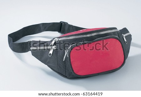 Nylon waist pouch for keeping mobile phone, wallet, and camera. - stock photo