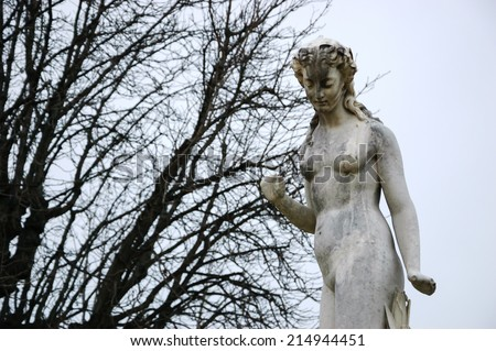 Nymphe marble statue in Tuileries gardens in cloudy winter day. - stock photo
