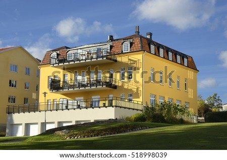 Nynashamn - a view of a colorful buildings on a public park. Nynashamn is located far south in Sodertorn, 58 kilometers south of Stockholm.