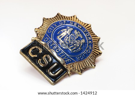 nypd police detective shield close-up on white background - stock photo