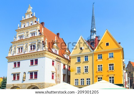 Nysa - a view of a colorful buildings on a market square. Nysa (German: Neisse) is a town in southwestern Poland. Nysa is one of the oldest towns in Silesia.  - stock photo