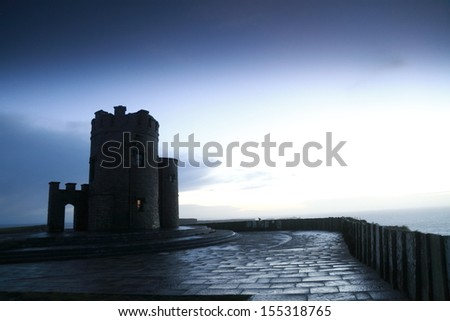 O Briens Tower at the Cliffs of Moher at sunset - stock photo