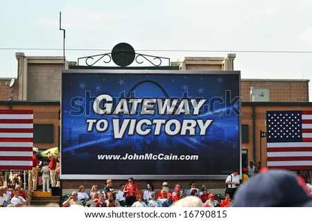 O'FALLON - AUGUST 31: A crowd gathers before Senator McCain and Saran Palin make their appearance at a rally in O'Fallon near St. Louis, MO on August 31, 2008 - stock photo