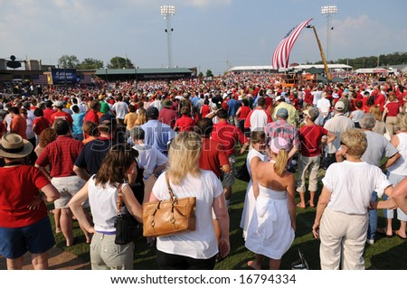 O'FALLON - AUGUST 31: Crowds gather at a McCain - Palin rally in O'Fallon near St. Louis, MO on August 31, 2008 - stock photo