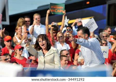 O'FALLON - AUGUST 31: Governors Saran Palin (L) and Mitt Romney at a John McCain rally August 31, 2008 in O'Fallon, St. Louis, MO. - stock photo