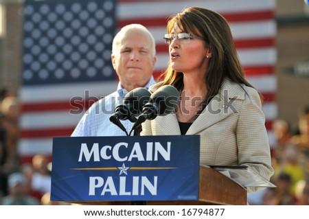 O'FALLON - AUGUST 31: Saran Palin speaks as Senator McCain looks on at an appearance in O'Fallon near St. Louis, MO on August 31, 2008 - stock photo