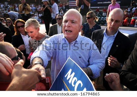 O'FALLON - AUGUST 31: Senator McCain and wife Cindy shake hands with the crowd at rally in O'Fallon near St. Louis, MO on August 31, 2008 - stock photo