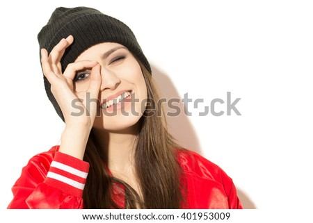 O for Optimism. Young happy attractive woman showing okay gesture. - stock photo