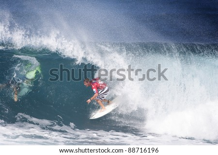 OAHU, HI - CIRCA 2005: Three time world champion surfer, Andy Irons, competes in the Billabong Pipe Masters circa 2005 in Oahu, Hawaii. Andy Irons passed away unexpectedly on November 2, 2010. - stock photo