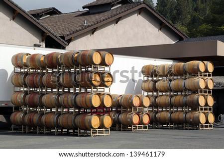 Oak barrels at the vineyard - stock photo