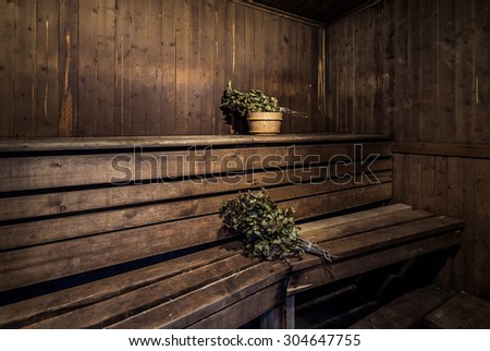 Oak brooms inside of a bath house - stock photo