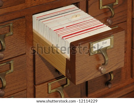Oak card catalog file with one drawer open - stock photo