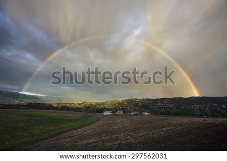 Oak View, California, USA, March 1, 2015, full rainbow over rain storm in Ojai Valley