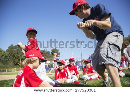 Oak View, California, USA, March 7, 2015, Ojai Valley Little League Field, youth Baseball, Spring, coach teaches Tee-Ball Division players - stock photo