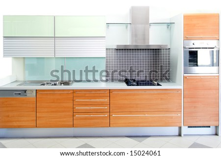 Oak wood kitchen with blue glass details - stock photo