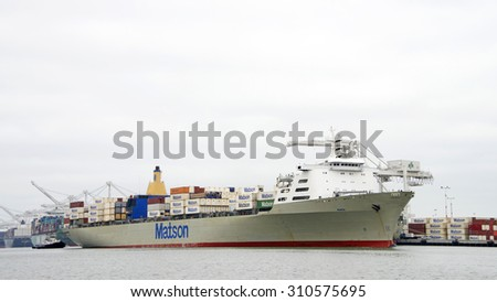 OAKLAND, CA - AUGUST 24, 2015: Matson Cargo Ship MANOA entering the Port of Oakland. Matson provides shipping services Pacific wide. Mainly to and from the Hawaiian Islands.