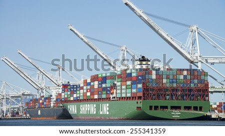 OAKLAND, CA - FEBRUARY 23, 2015: CSCL SPRING and APL EGYPT docked at the Port of Oakland. No cranes are seen running due to a reported shortage of experienced crane operators.