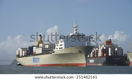 OAKLAND, CA - FEBRUARY 09, 2015: Matson Ship MANOA entering the Port of Oakland. The Port of Oakland loads and discharges more then 99 percent of containerized goods moving through Northern California