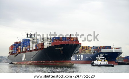 OAKLAND, CA - JANUARY 27, 2015: APL THAILAND entering the Port of Oakland with Tugboat Assist. Oakland's cargo volume makes it the fifth busiest container port in the United States