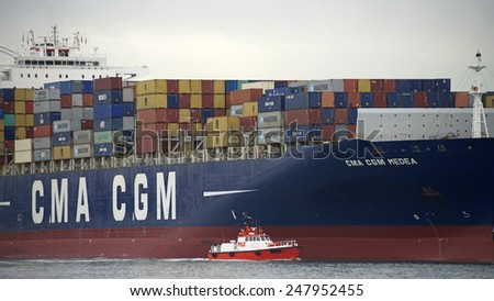 OAKLAND, CA - JANUARY 27, 2015: Pilot Vessel GOLDEN GATE at the Port of Oakland. Every day, the state-licensed Bar Pilots navigate commercial ships to and from the nine ports within San Francisco Bay. - stock photo