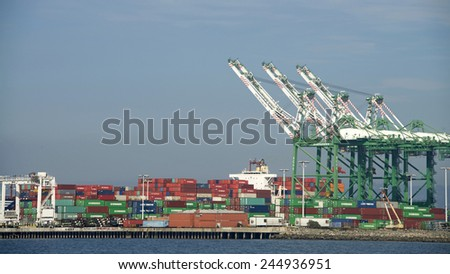 OAKLAND, CA - JANUARY 17, 2015: The Port of Oakland loads and discharges more then 99 percent of containerized goods moving through Northern California, the nation's fourth larges metropolitan area.