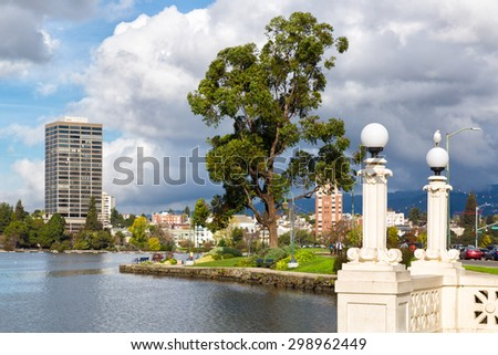 Oakland, CA Lake Merritt view of park along water's edge. Focus is on the vintage lampposts in the foreground. - stock photo