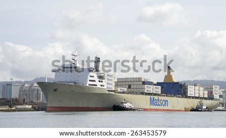 OAKLAND, CA - MARCH 23, 2015: Matson Cargo Ship MANOA entering the Port of Oakland. The Port of Oakland's cargo volume makes it the fifth busiest container port in the United States.