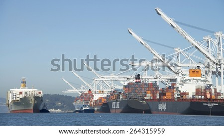 OAKLAND, CA - MARCH 25, 2015: Matson Cargo Ship MATSONIA entering the Port of Oakland. The Port of Oakland's cargo volume makes it the fifth busiest container port in the United States.