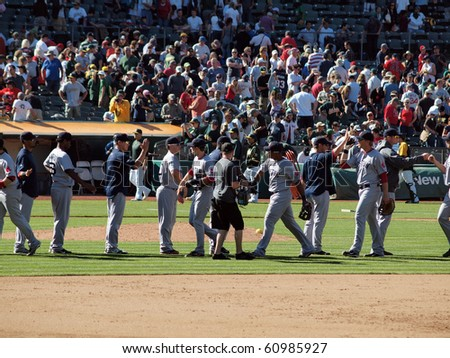 OAKLAND, CA - SEPTEMBER 12: Red Sox vs. A's: The 2010 Red Sox shake hands at end of game to celebrate win.  September 12 2010 Coliseum Oakland California - stock photo