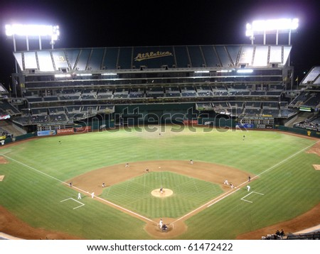 OAKLAND, CA - SEPTEMBER 21: White Sox vs. Athletics: Pitcher Mark Buehrle throws pitch to batter with runner on 1st. Football line visible on field. September 21 2010 Coliseum Oakland California. - stock photo
