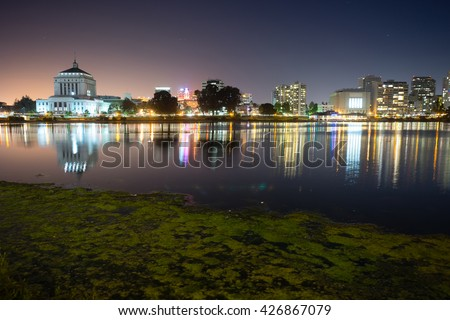 Oakland California Night Sky Downtown City Skyline Lake Merritt - stock photo