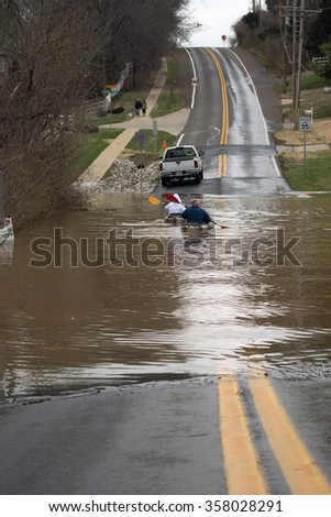 OAKVILLE, MISSOURI/USA - DEC. 31, 2015: Flood water from the Meramec River overtakes Heintz Road near the intersection of Cambridge Meadows in the St. Louis community of Oakville.