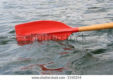 Oar closeup in the water - stock photo