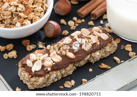 oat bar with chocolate and nuts, close-up, top view - stock photo