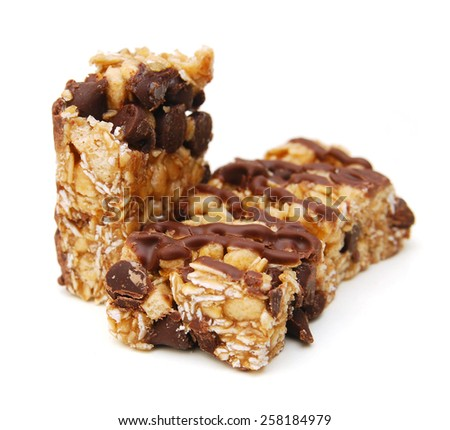 Oat bars with chocolate on white background  - stock photo
