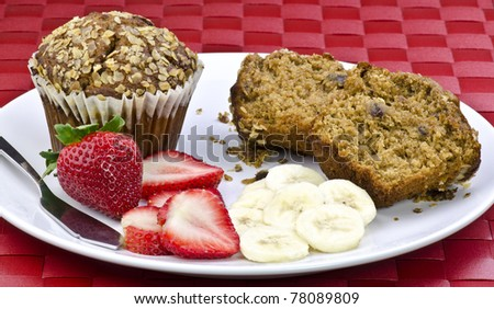 oat bran muffins and fresh fruit - stock photo