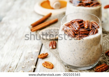 oat cinnamon Chia seed pudding with honey pecan. the toning. selective focus - stock photo